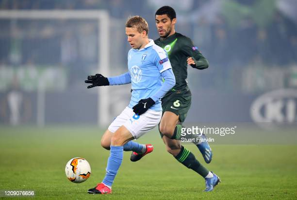 Paulo Otavio of VfL Wolfsburg battles for possession with Oscar Lewicki of Malmo FF during the UEFA Europa League round of 32 second leg match...