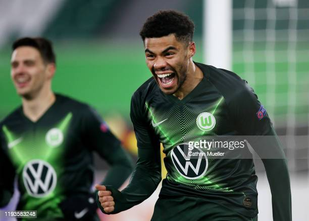 Paulo Otavio of VfL Wolfsburg celebrates after scoring his team's first goal during the UEFA Europa League group I match between VfL Wolfsburg and AS...