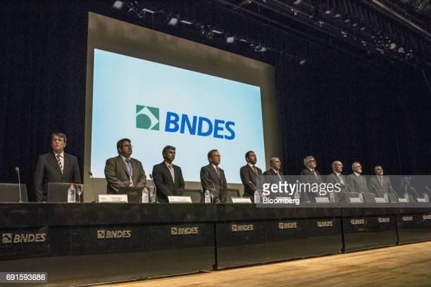 Paulo Rabello de Castro chief executive officer of Banco Nacional de Desenvolvimento Economico Social fourth left stands with BNDES executives during...