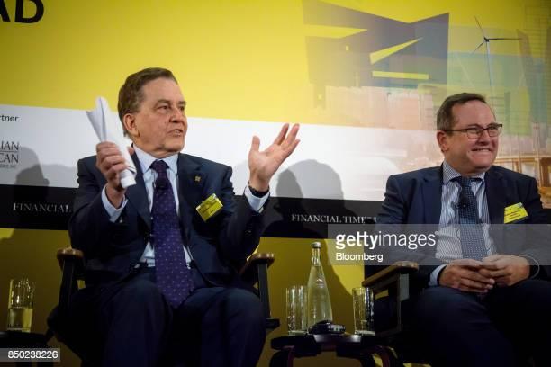Paulo Rabello de Castro chief executive officer of Banco Nacional de Desenvolvimento Economico Social left speaks as Eduardo Navarro de Carvalho...