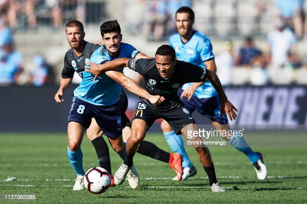 Paulo Retre of Sydney and Kearyn Baccus of Melbourne City contest the ball during the round 17 ALeague match between Sydney FC and Melbourne City at...