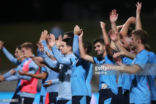 Paulo Retre of Sydney FC celebrates victory with team mates at full-time during the A-League match between Sydney FC and the Melbourne Victory at...
