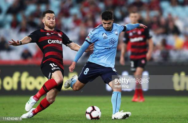 Paulo Retre of Sydney FC is challenged by Alexander Baumjohann of the Wanderers during the round 25 ALeague match between the Western Sydney...