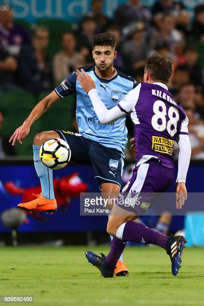 Paulo Retre of Sydney traps the ball against Neil Kilkenny of the Glory during the round 25 ALeague match between the Perth Glory and Sydney FC at...