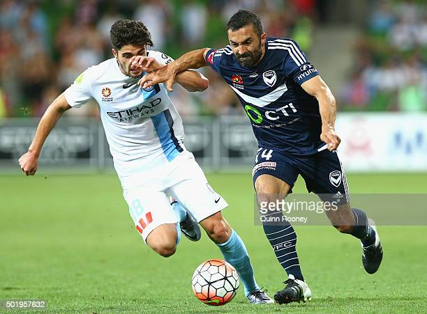 Paulo Retre of the City and Fahid Ben Khalfallah of the Victory competes for the ball during the round 11 ALeague match between Melbourne City FC and...