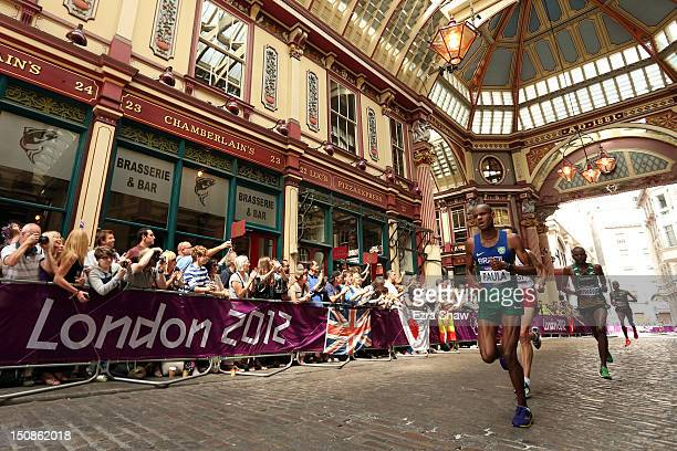 Paulo Roberto de Almeida Paula of Brazil runs through Leadenhall Market as he competes in the Men's Marathon on Day 16 of the London 2012 Olympic...