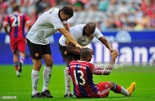 Paulo Sergio of FCB AllStars jokes with Ronny Johnson and Dion Dublin of ManUtd Legends during the friendly match between FC Bayern Muenchen AllStars...