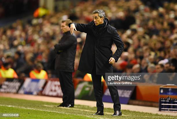 Paulo Sousa the head coach of FC Basel directs his players as Brendan Rodgers the manager of Liverpool looks on during the UEFA Champions League...