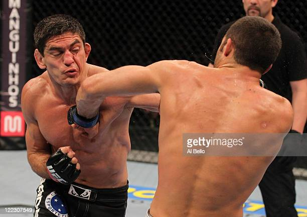 Paulo Thiago and David Mitchell trade punches during a welterweight bout at UFC 134 at HSBC Arena on August 27 2011 in Rio de Janeiro Brazil