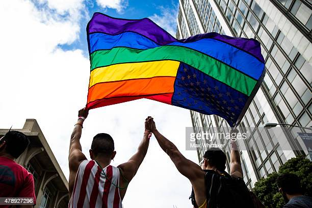 Paulo Torres left dances with his husband Victor Tsang right after the San Francisco Gay Pride Parade June 28 2015 in San Francisco California