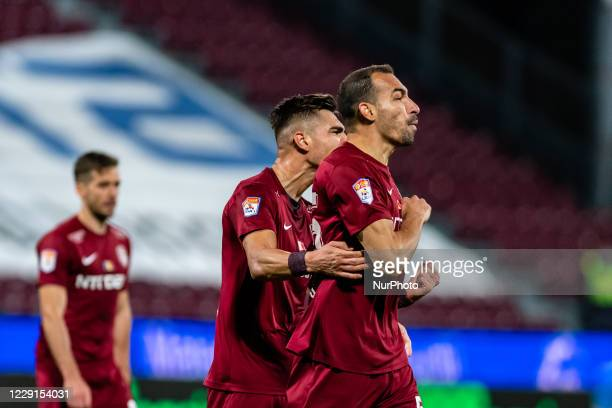 Paulo Vinicius and Denis Ciobotariu, defenders of CFR Cluj celebrating after scoring victory goal during the 7th game in the Romania League 1 between...