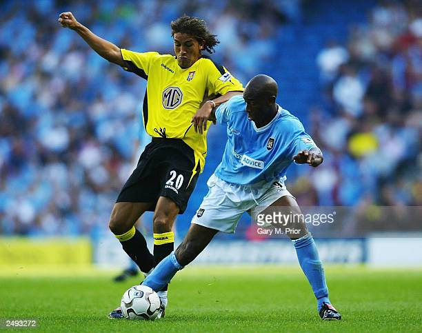 Paulo Wanchope of Manchester City and Mustapha Hadji of Aston Villa in action during the FA Barclaycard Premiership match between Manchester City and...