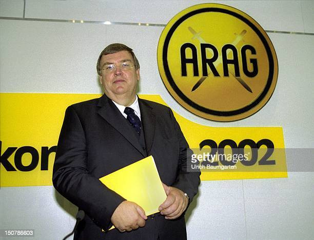 PaulOtto FASSBENDER chairman of the board of management of the ARAG during press conference next to the ARAG Logo