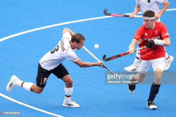 Paul-Philipp Kaufmann of Team Germany and Liam Sanford of Team Great Britain battle for a loose ball during the Men's Preliminary Pool B match...