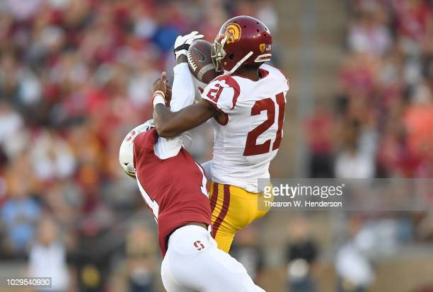Paulson Adebo of the Stanford Cardinal breaks up the pass to Tyler Vaughns of the USC Trojans in the second quarter of an NCAA football game at...
