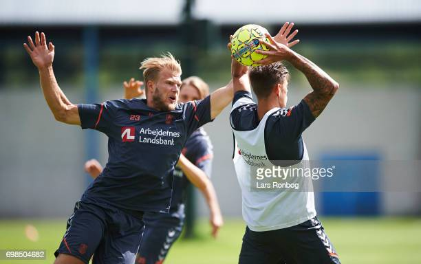 Paulus Arajuuri and Jan Kliment of Brondby IF compete for the ball during the Brondby IF training session at Brondby Stadion on June 20 2017 in...