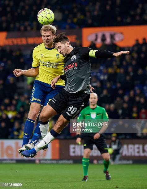 Paulus Arajuuri of Brondby IF and Alexander Juel Andersen of Vendsyssel FF compete for the ball during the Danish Superliga match between Brondby IF...