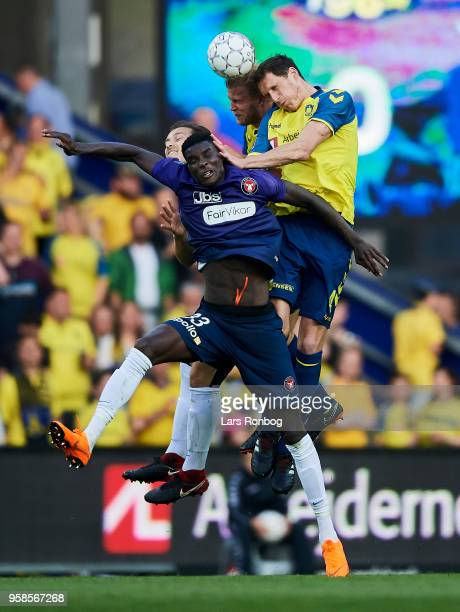 Paulus Arajuuri of Brondby IF Benedikt Rocker of Brondby IF Erik Sviatchenko of FC Midtjylland and Paul Onuachu of FC Midtjylland compete for the...