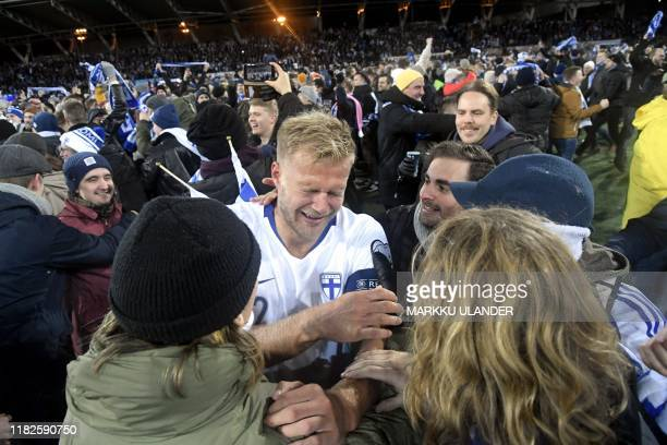 Paulus Arajuuri of Finland celebrates with fans after the UEFA Euro 2020 Group J qualification football match between Finland and Liechtenstein in...