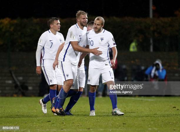 Paulus Arajuuri of Finland celebrates with his teammates after scoring during the 2018 FIFA World Cup European Qualification Group I match between...