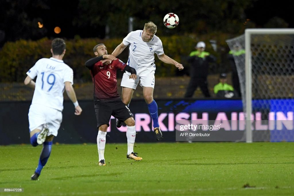 Paulus Arajuuri (R) of Finland heads the ball next to Cenk Tosun of Turkey during the FIFA World Cup 2018 qualifying football match between Finland and Turkey in Turku, Southern Finland on October 9, 2017. / AFP PHOTO / Lehtikuva / Antti Aimo-Koivisto / Finland OUT