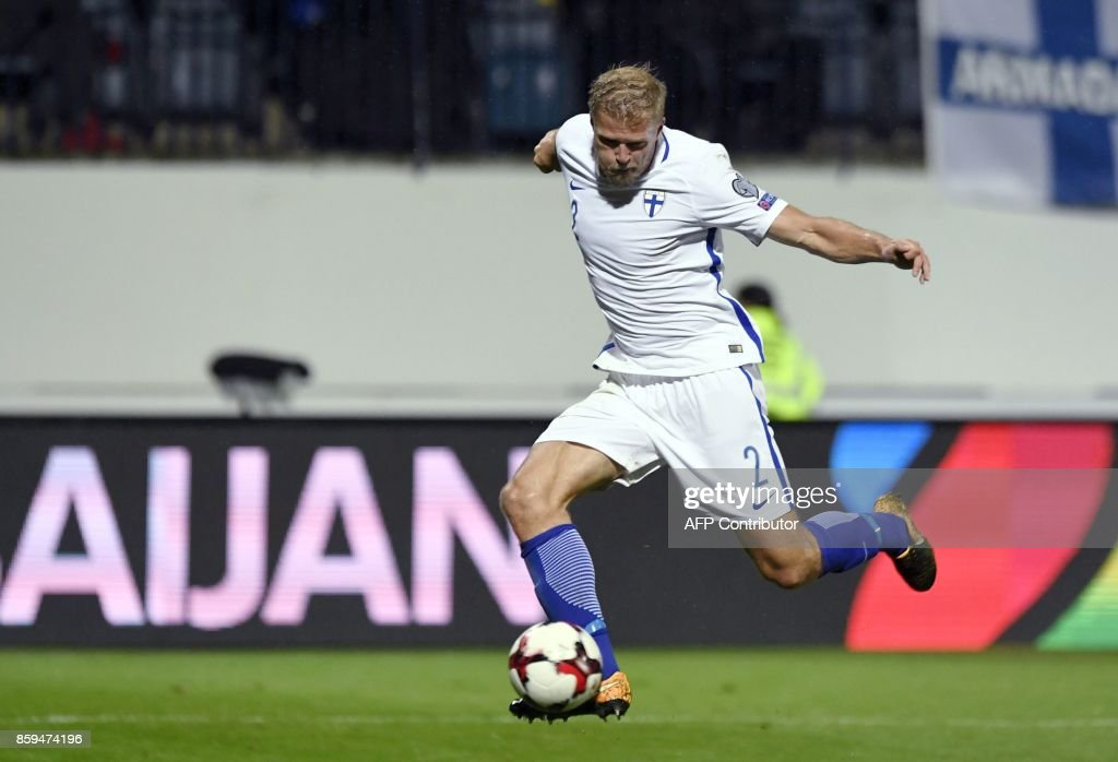 Paulus Arajuuri of Finland shoots to score the 1-1 equalizer during the FIFA World Cup 2018 qualifying football match between Finland and Turkey in Turku, Southern Finland on October 9, 2017. / AFP PHOTO / Lehtikuva / Antti Aimo-Koivisto / Finland OUT