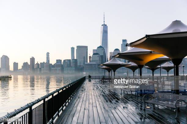 paulus hook pier in jersey city and manhattan downtown skyline in new york city, united states - new jersey stock pictures, royalty-free photos & images