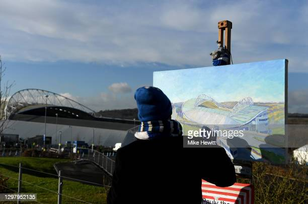 Pauly the Painter is seen painting a picture of the Amex Stadium prior to The Emirates FA Cup Fourth Round match between Brighton And Hove Albion and...