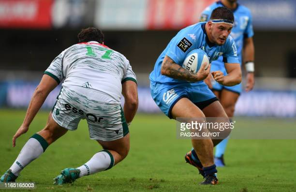 Pau's Argentine prop Ignacio David Calles fights for the ball with Montpellier's French hooker Vincent Giudicelli during the French Top 14 rugby...