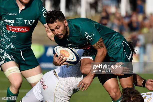 Pau's Conrad Smith is tackled during the French Top 14 rugby union match between Agen and Pau on September 23 2017 at the Armandie Stadium in Agen...