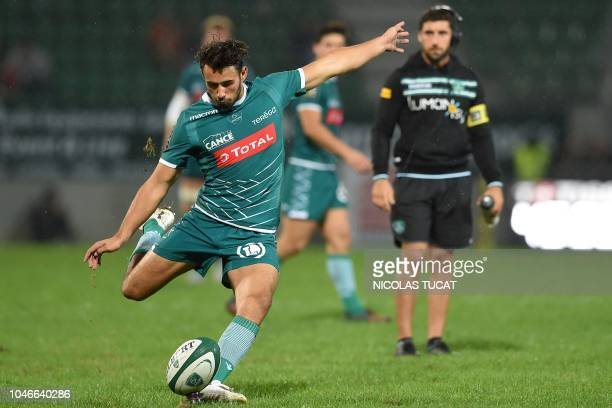 Pau's French flyhalf Antoine Hastoy kicks the ball during the French Top 14 rugby union match between Pau and Perpignan at the Hameau stadium in Pau...