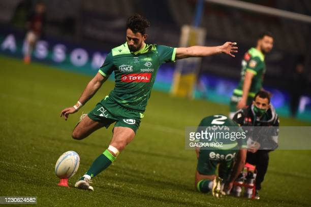 Pau's french fly-half Antoine Hastoy kicks the ball during the French Top14 rugby union match between Aviron Bayonnais and Section Paloise at the...