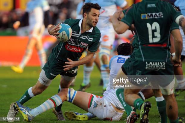 Pau's French fullback Charly Mahe runs with the ball during the French Top 14 rugby union match between Bayonne's Aviron Bayonnais and Pau's Section...