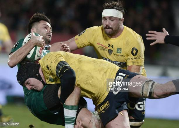 TOPSHOT Pau's french fullback Charly Malie vies with Clermont's Drench second row Arthur Iturria during the French Top 14 rugby union match between...