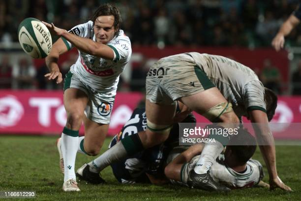 Pau's French scrumhalf Clovis Le Bail passes the ball during the French Top 14 rugby union match between Section Paloise and SU Agen at the Hameau...