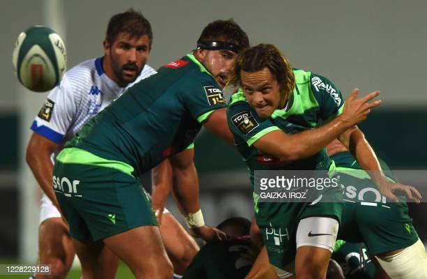 Pau's French scrum-half Clovis Le Bail passes the ball during the friendly French Top 14 rugby union match between Section Paloise and Castres...