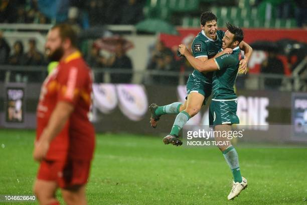 Pau's French scrumhalf Thibault Daubagna and Pau's French flyhalf Antoine Hastoy celebrate at the end of the French Top 14 rugby union match between...