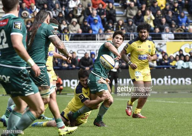 Pau's French scrumhalf Thibault Daubagna passes the ball during the French Top 14 rugby match between Clermont and Pau at the Michelin stadium in...