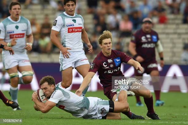 Pau's French winger Adrien Plante vies with BordeauxBegles' Australian wing Blair Connor during the French Top 14 rugby union match between...
