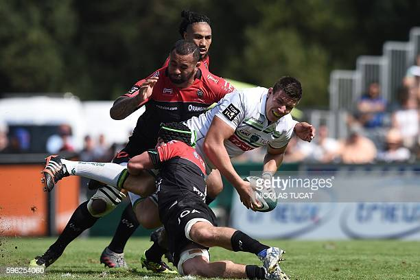 Pau's Irish flanker James Coughlan is tackled during the French Top 14 rugby union match between Pau and Toulon on August 27 2016 at the Hameau...