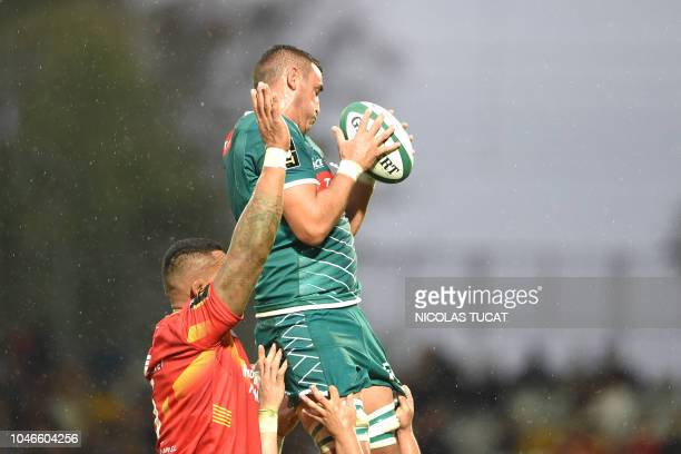 Pau's Irish flanker Paddy Butler grabs the ball in a line up during the French Top 14 rugby union match between Pau and Perpignan on October 6, 2018...