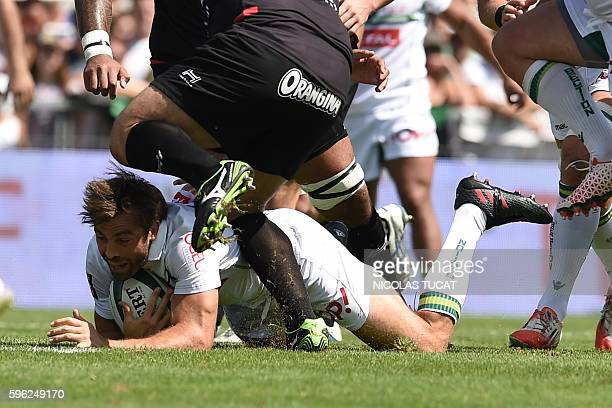 Pau's New Zealander centre Conrad Smith collapses during the French Top 14 rugby union match between Pau and Toulon on August 27 2016 at the Hameau...