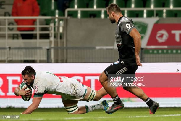 Pau's New Zealander second row Daniel Ramsay scores a try during the French rugby union Top 14 match between Pau and Brive on November 18, 2017 at...