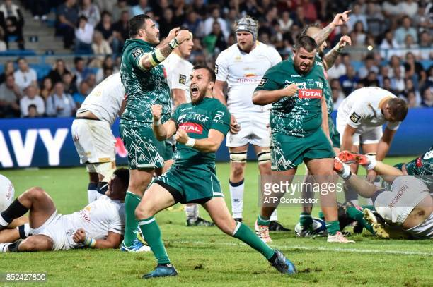 Pau's player Brandon Fajardo celebrates victory during the French Top 14 rugby union match between SU Agen and Pau on September 23 2017 at the...