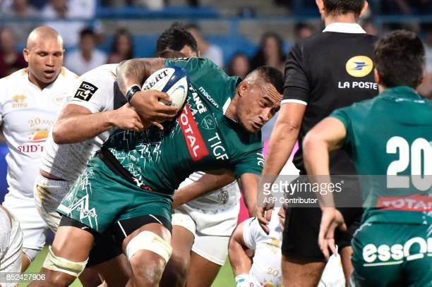 Pau's player Masalosalo Tutaia runs with the ball during the French Top 14 rugby union match between SU Agen and Pau on September 23 2017 at the...