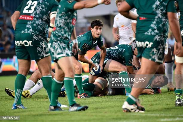 Pau's player Thibault Daubagna throws the ball during the French Top 14 rugby union match between SU Agen and Pau on September 23 2017 at the...