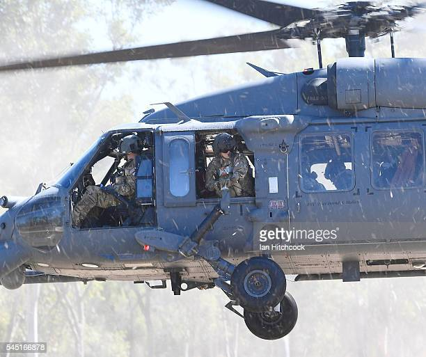 HH60 Pave Hawk helicopter flies comes into land near the site of a simulated IED stike on July 6 2016 in Townsville Australia Exercise Angel Reign is...