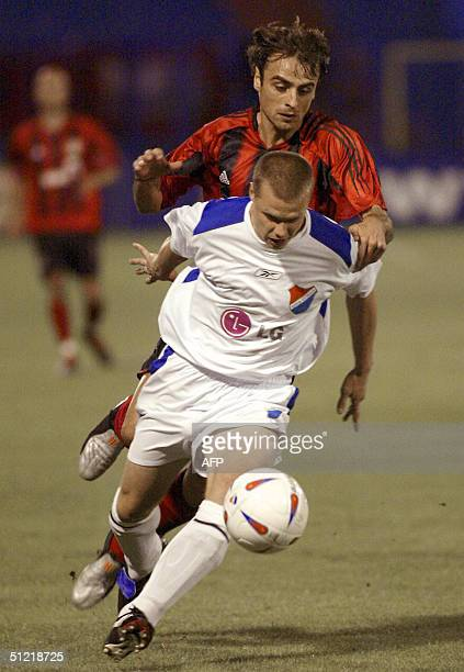 Pavel Besta from Banik Ostrava vies with Dimitar Berbatov from Bayer Leverkusen during the third pre-round second leg Champions League match 25...
