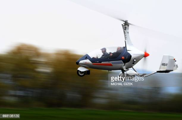 Pavel Brezina owner of Nirvana Autogyro company flies with his autogyro at the airport near Pribram city in the Czech Republic on April 27 2017 As...