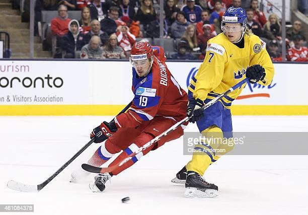 Pavel Buchnevich of Team Russia skates against Julius Bergman of Team Sweden during a semifinal game in the 2015 IIHF World Junior Hockey...